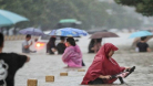 চীনে বন্যার পানিতে ১২জনের মৃত্যু